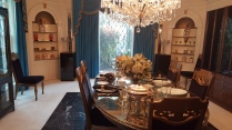The dining room. Elvis searched high and low for the blue curtains.