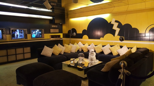 Yellow leather, 6 televisions and wall to ceiling mirrors.