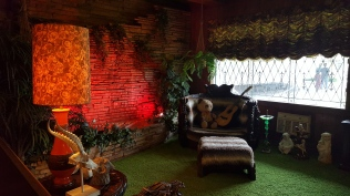 This is the Jungle Room, the red spotlight is where the indoor waterfall is.